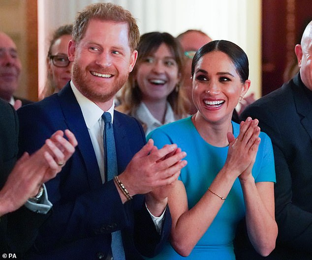 The Duke and Duchess of Sussex in London in March 2020 before they quit as senior royals