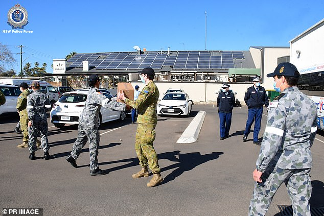Australian Defence Force personnel assist NSW Police with Food Bank deliveries in Dubbo, NSW on August 18, 2021