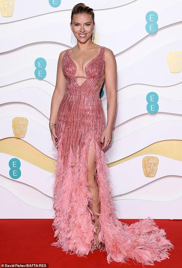 Mother of two: Scarlett poses on BAFTA's red carpet last February