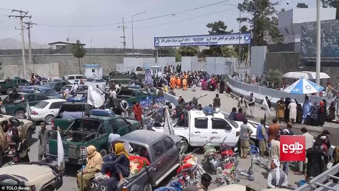 On guard: Taliban fighters guard southern entry to Kabul airport yesterday