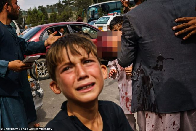Tears: A boy cries after fanatics used sticks to break up a crowd near the airport