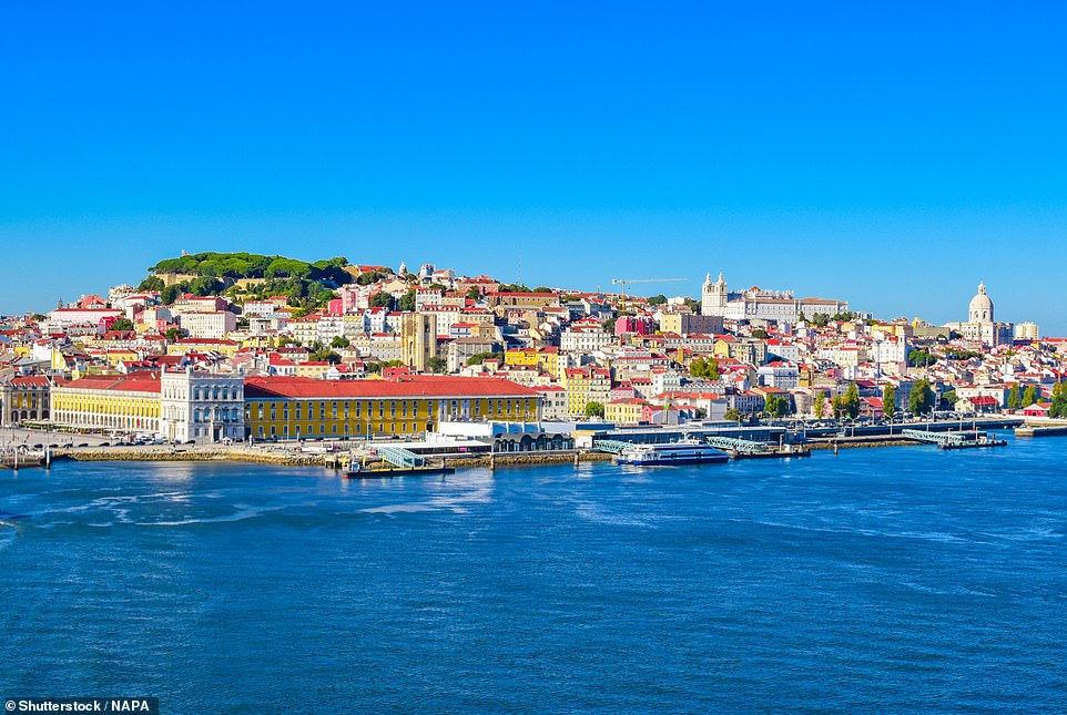 The Portuguese capital has become an astonishing open-air art gallery. Pictured is the city's port