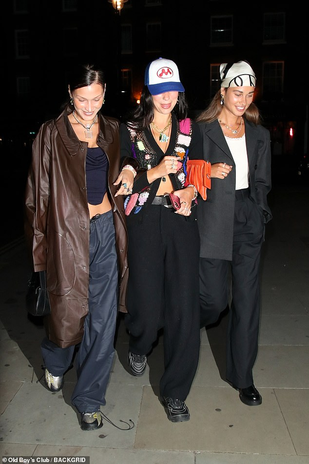 Pals: Dua Lipa (centre) stepped out for dinner at Chiltern Firehouse in London with Bella Hadid (left) and her boyfriend Marc Kalman on Friday night