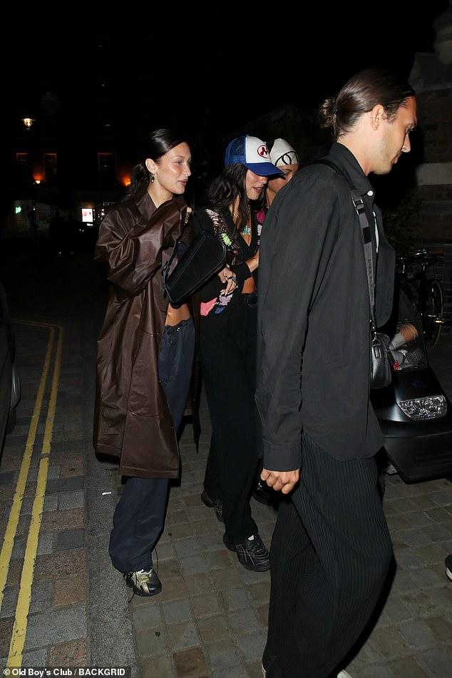 Out and about: Bella looked glowing with a radiant slick of makeup and wore her dark tresses in a low pony tail