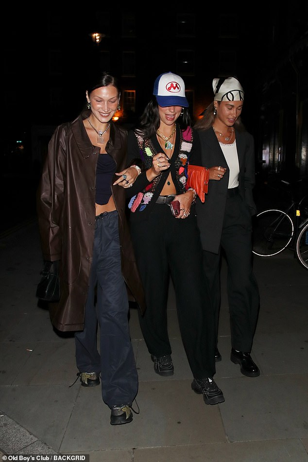 Strutting their stuff: The trio all linked arms as they made their way to the celebrity hotspot for dinner