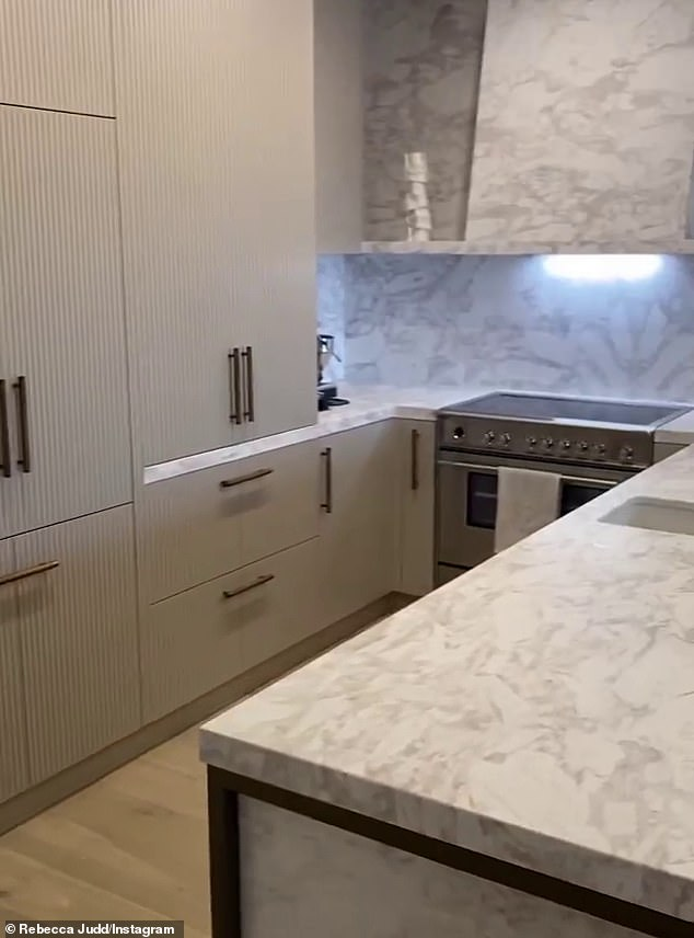 Luxe: Her kitchen was decked out with modern and minimal joinery, top-of-the-range appliances, with marble splash back and bench