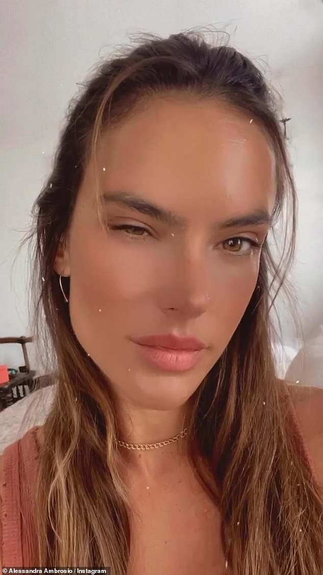 Flirty: The legendary Victoria's Secret Angel also gave a wink straight into the camera