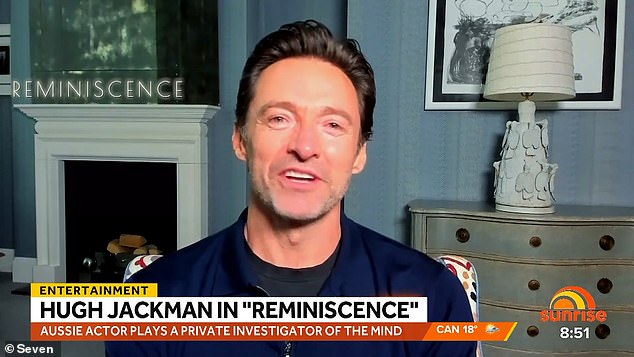 Cheeky! On Saturday, Hugh Jackman shared his excitement for his new film Reminiscence during a TV interview - before taking a cheeky dig at pal Ryan Reynolds