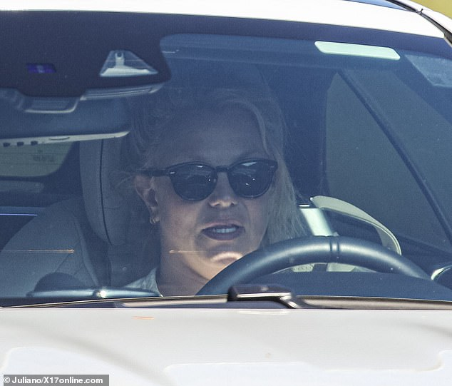 The look:The 39-year-old was stepping out for a solo drive, letting her signature blonde hair down and warding off the California rays with dark shades