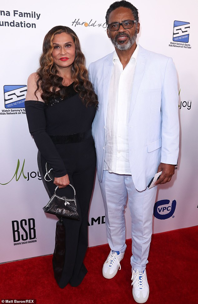 Side by side:She could be spotted posing up solo as well as beside her second husband Richard Lawson whom she married in 2015