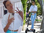 Alessandra Ambrosio shows off fit figure in leggings and crop top while riding scooter to yoga class