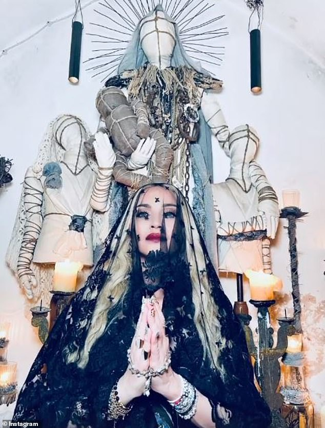 Madonna: The music icon looked put on her best angelic phase as she posed in front of an alter in a black lace veil on her Instagram stories