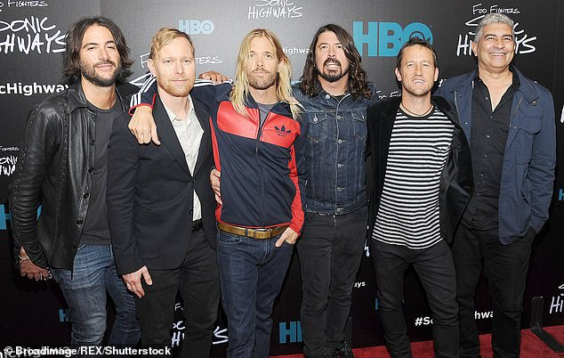 Family man: Grohl concluded the interview by pointing out that his home life was 'wonderfully mundane'; he is seen with the other Foo Fighters members in 2014