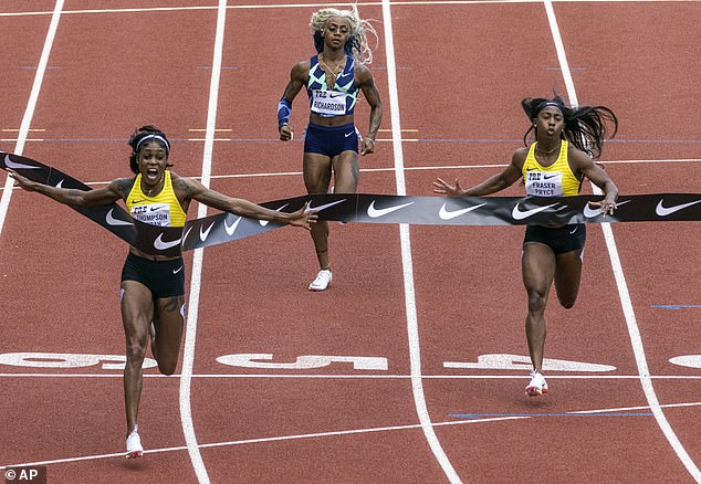Jamaica's Elaine Thompson-Herah, left, wins the 100 meters, as American track and field sprinter Sha'carri Richardson, center, also competes on Saturday