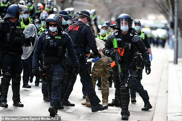 At least nine officers ended up in hospital after being pelted with projectiles, punched and kicked by members of a 4,000-strong crowd on Saturday