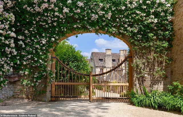 The walk is routed past Grade II listed Asthall Manor (pictured here through an arch), where the Mitford sisters famously lived