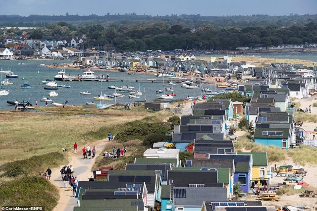 There are about 360 huts on the Mudeford sandbank that is so remote it requires a 20 minute walk to get to, a ride on a land train or a short ferry ride across Christchurch Harbour (pictured) and none of the wooden huts have electricityor toilets