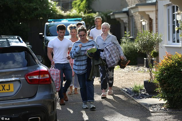 Rallying: Friends and family are rallying around Katie to give her strength to pursue a conviction (pictured are friends collecting belongings from the house the attack took place in)