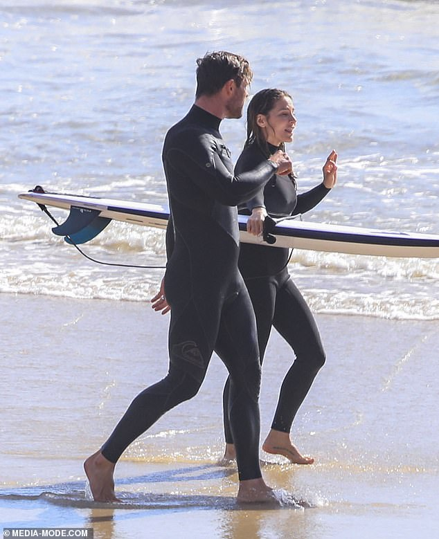 Surf's up:At another point, the pair were seen walking on the shore and having a little chat as Elsa carried her board around