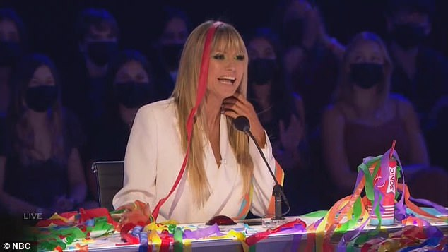 Good times: Heidi Klum enjoyed the routine and danced during the performance