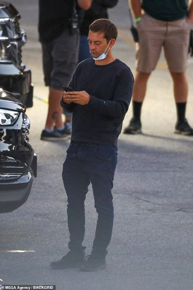 Interesting: He sported all black including sweater, jeans, and sneakers