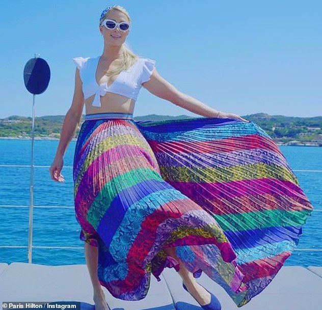 Last days of summer: The purse designer was seen pulling out her skirt to flow in the wind