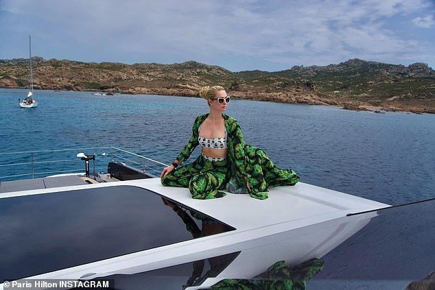'Captain Paris in Paradise!' Paris Hilton shows off her taut tummy while lounging on luxury yacht in Corsica on Wednesday