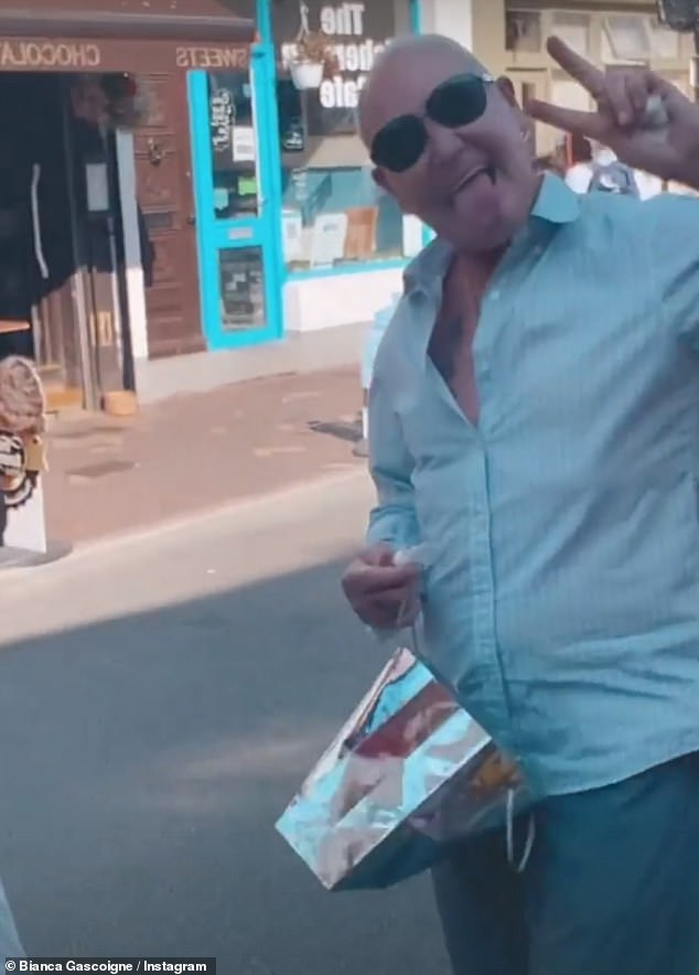 Highstreet: In a short clip Paul could be seen flashing fans a peace sign while strolling down a highstreet