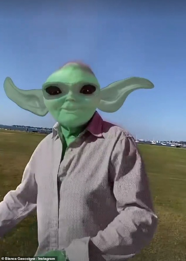 Hilarious:Bianca also added a hilarious alien filter to her famous dad as he danced through a green field