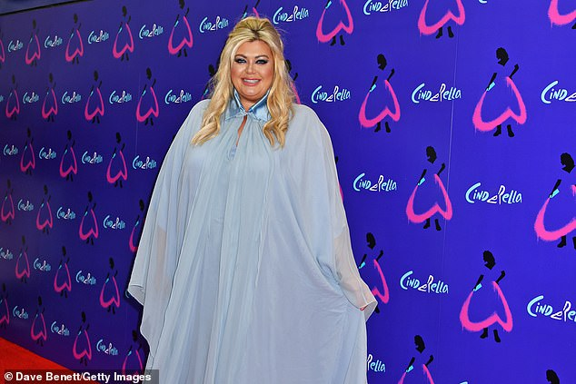 Pose: Gemma's outfit featured a high collar while she styled her blonde locks into loose curls