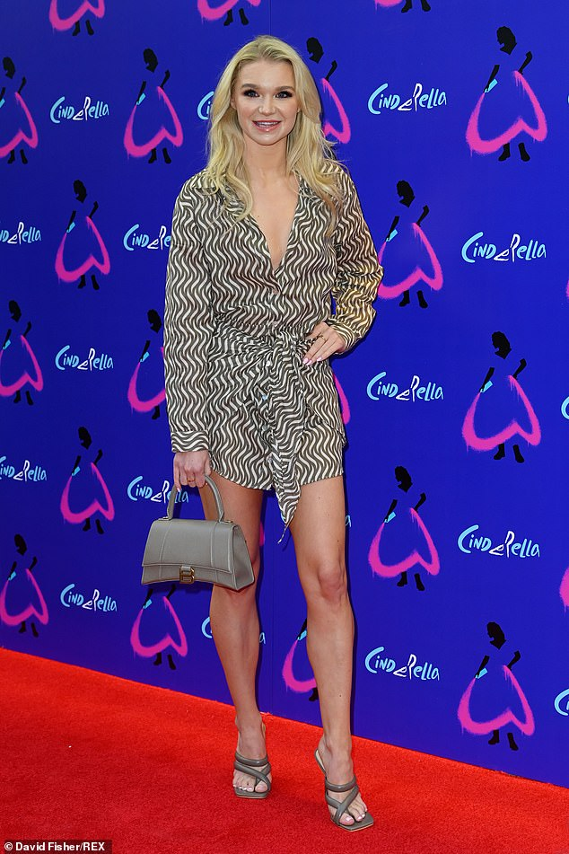 Incredible:Abbie put on a leggy display in a printed long-sleeved mini dress which she paired with silver heels