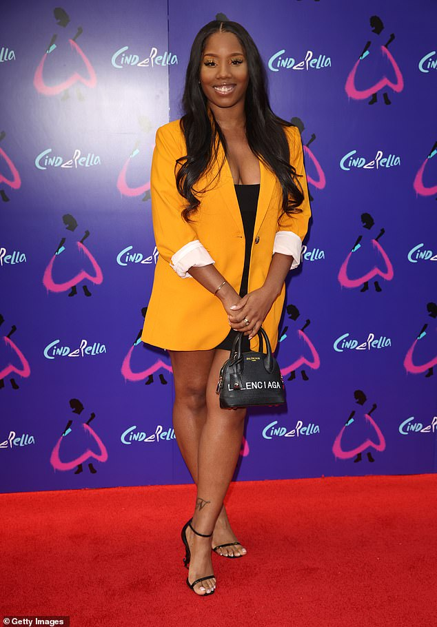 Flawless: Radio presenter Nadia Jae sported a black mini dress which she paired with matching heels and an orange blazer