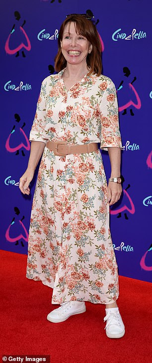 Accessories: The broadcaster cinched her waist with a beige belt