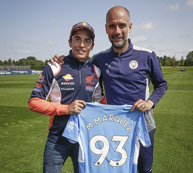 Pep Guardiola (right) invited eight-time motorsport champion Marc Marquez (left) to a Manchester City training session