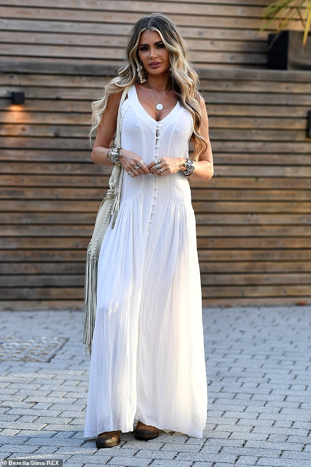Stepping out: She paired the relaxed maxi with a pair of brown suede cowboy boots and toted a tassled white shoulder bag