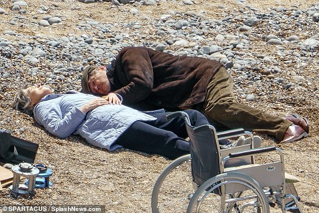 End of an filming era: Rupert and Gina were reclined on the beach together in one of the snaps