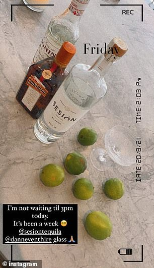 Cheers: Uploading a photo of the bottle of Sesión Tequila, she wrote: 'I'm not waiting til 3pm today. It's been a week'