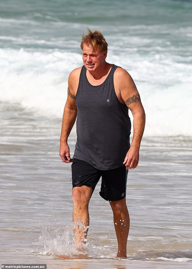 'Tom Markle here coming to you live from the Big Brother VIP hotel backyard, you know, where rations get a little low, so he makes us run outside here in the ocean and get her own food,' he joked in the beachside clip