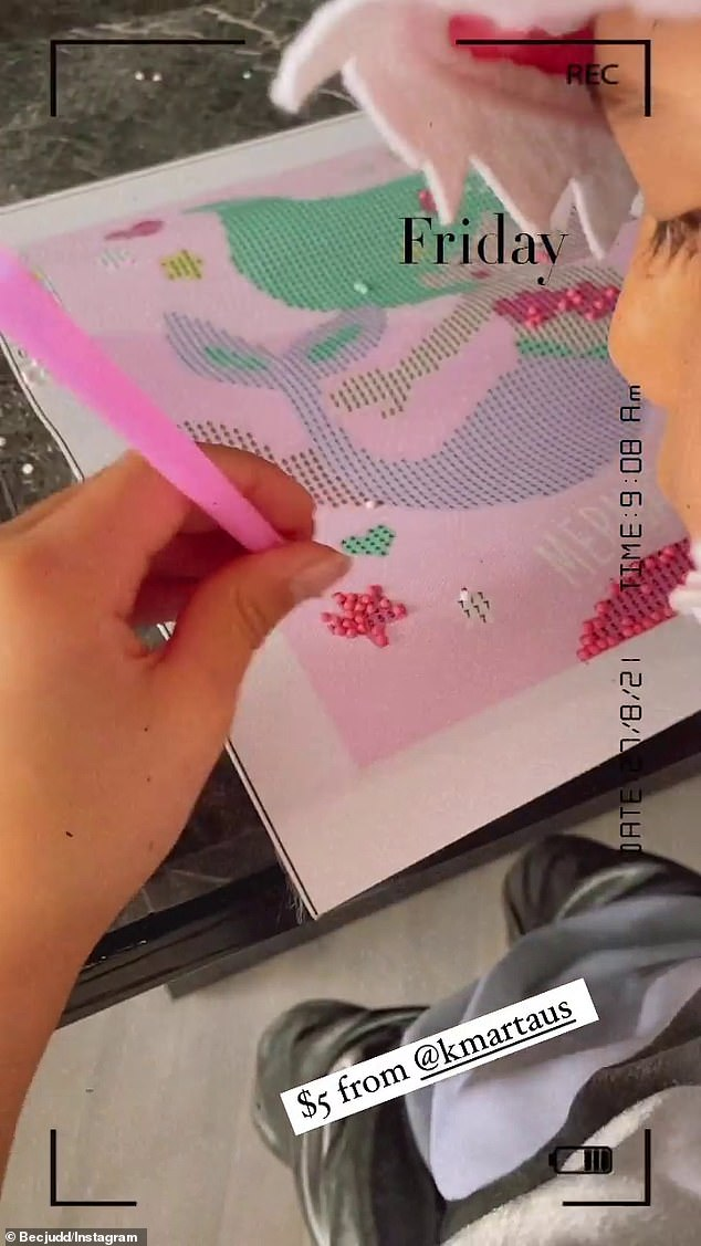 Creative: Bec's son was seen putting pink gems on the mermaid artwork