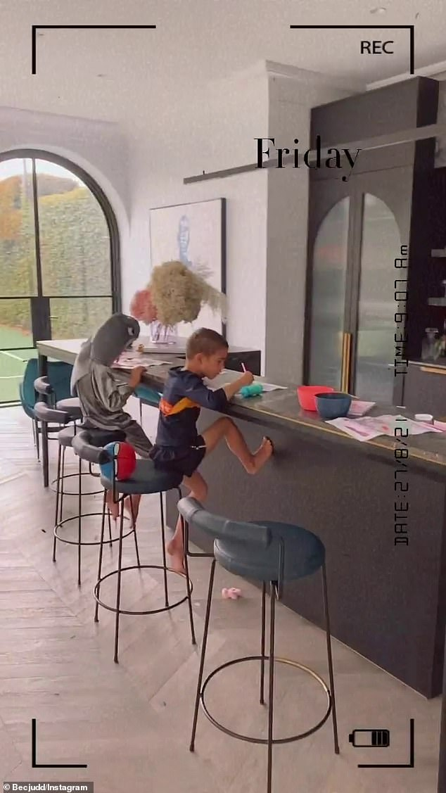 Busy: The footy WAG and wife to AFL legend Chris Judd gave each of her twin boys Darcy and Tom, four, a Sparkle Gem Art Set from Kmart to complete on Friday. Her sons are pictured