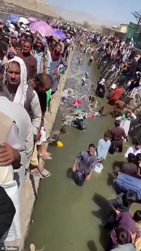 Afghans desperate to flee the country returned to the fetid canal which runs the perimeter of Kabul airport