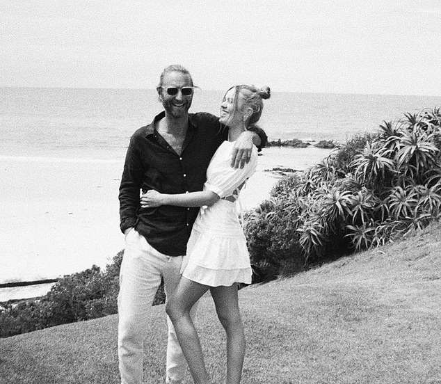 Sweet:'Happy birthday' the 25-year-old beauty captioned the sweet set of black and white images.One photo showed the couple embracing on a cliffside