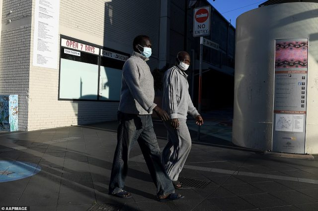 Most of the 12 local government areas 'of concern' have large immigrant populations, including Fairfield, Canterbury-Bankstown, Campbelltown, Blacktown and Liverpool. Two men are pictured walking at Blacktown