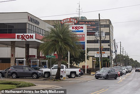 Lines at gas stations flowed into the streets and an Exxon in New Orleans has already closed its pumps because it is out of gas