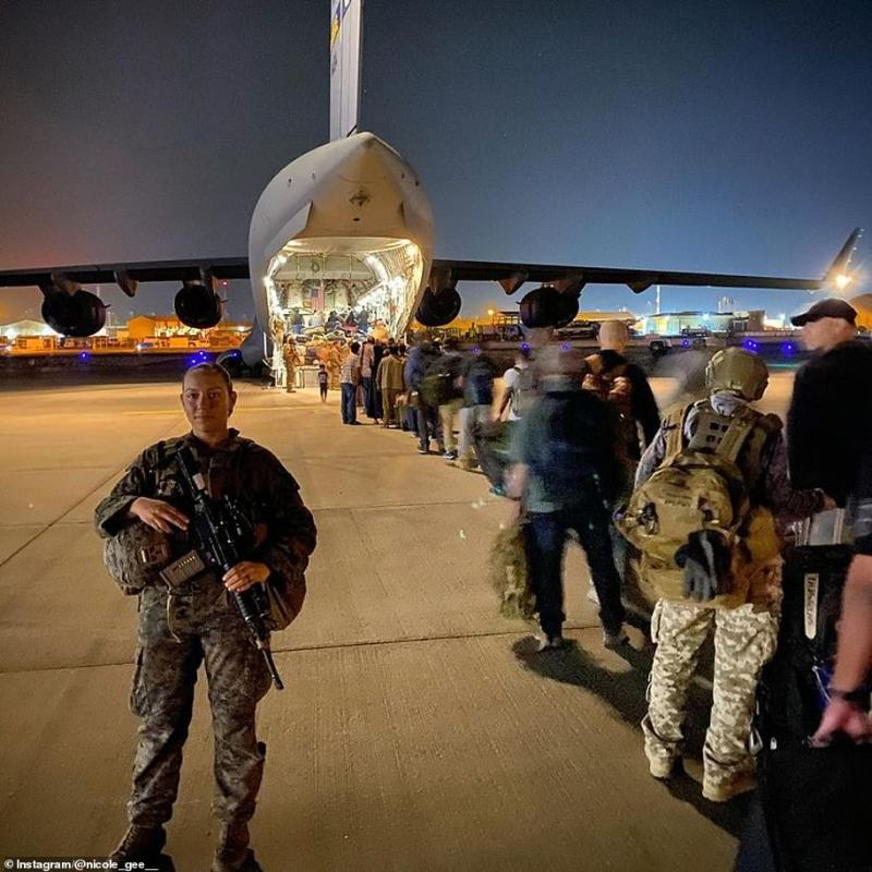 Marine Sgt. Nicole Gee, 23, is seen four days before she was killed, escorting Afghans on to a plane in Kabul