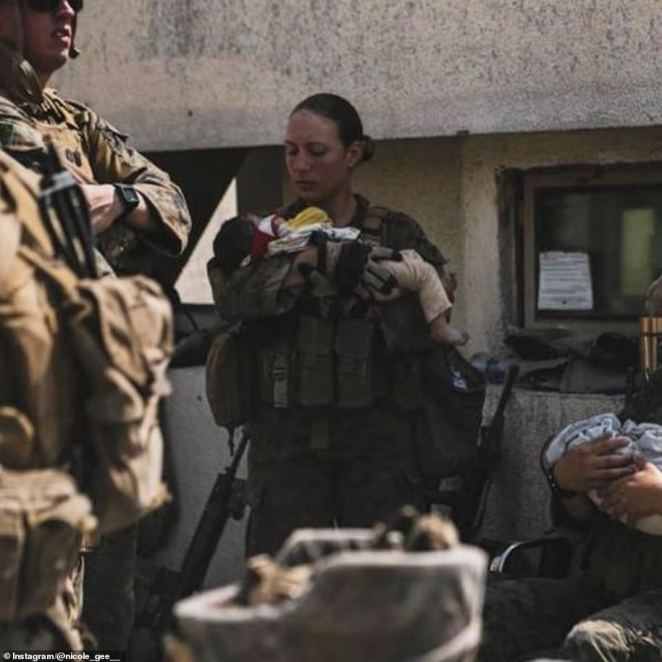 Just days before she was killed in the suicide blast, St. Nicole Gee was photographed holding an Afghan baby