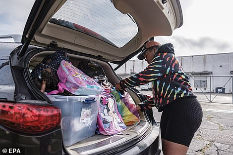 packs her vehicle full as she prepares to evacuate to Texas before the arrival of Hurricane Ida in New Orleans as residents are urged to evacuate if possible