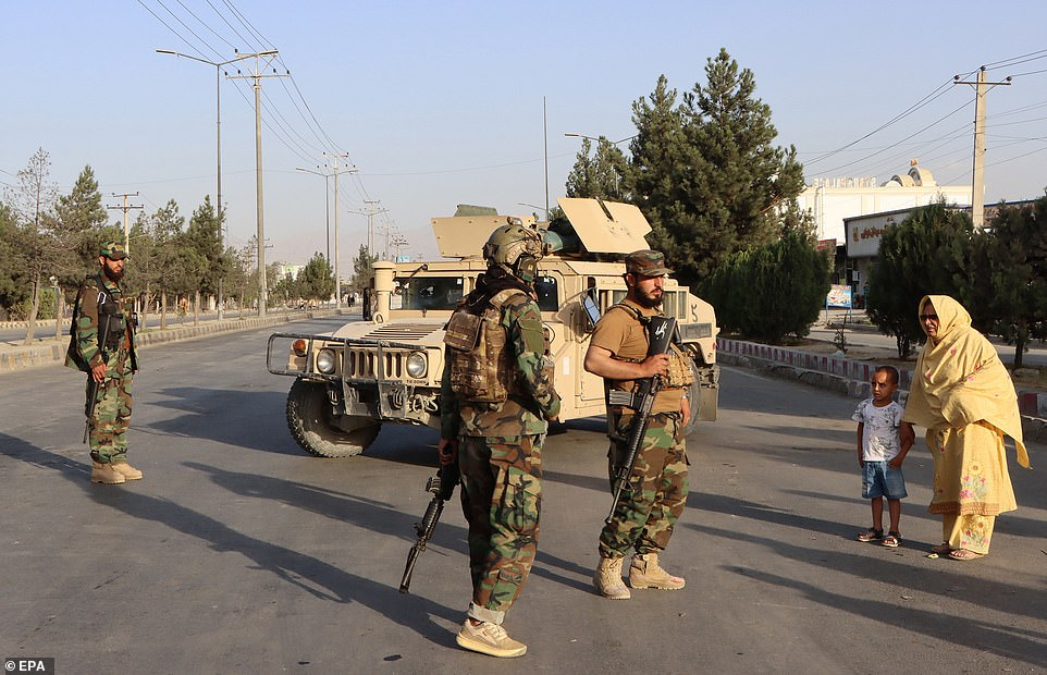 Taliban patrols outside the Hamid Karzai International Airport in Kabul, Afghanistan on Saturday. The Taliban has now effectively sealed off the airport, and the US Embassy is warning any Americans not to approach the gates