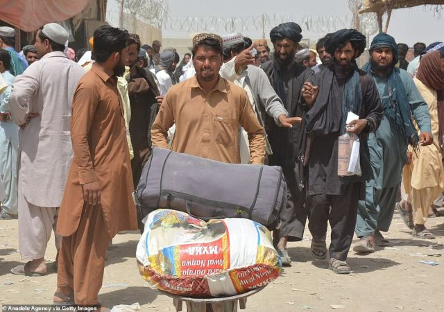 Pictured: Afghan people wait to enter Pakistan through Chaman border crossing in Chaman, Pakistan on August 28, 2021
