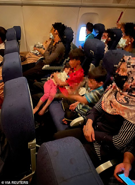 Afghan civilians being evacuated by an Italian jet